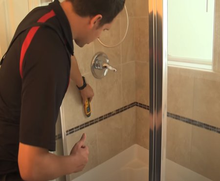 Bradford Home Inspections checking the moisture of the bathroom